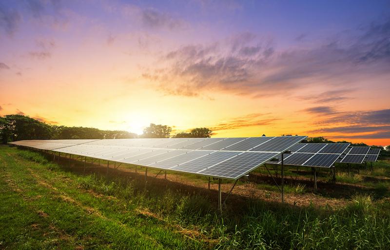 Solar Panel On Dramatic Sunset Sky Background, Alternative Energy Concept