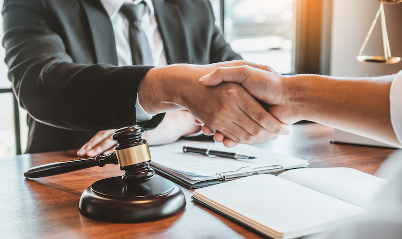 Businessman Shaking Hands To Seal A Deal Judges Male Lawyers Consultation Legal Services Consulting In Regard To The Various Contracts To Plan The Case In Court.