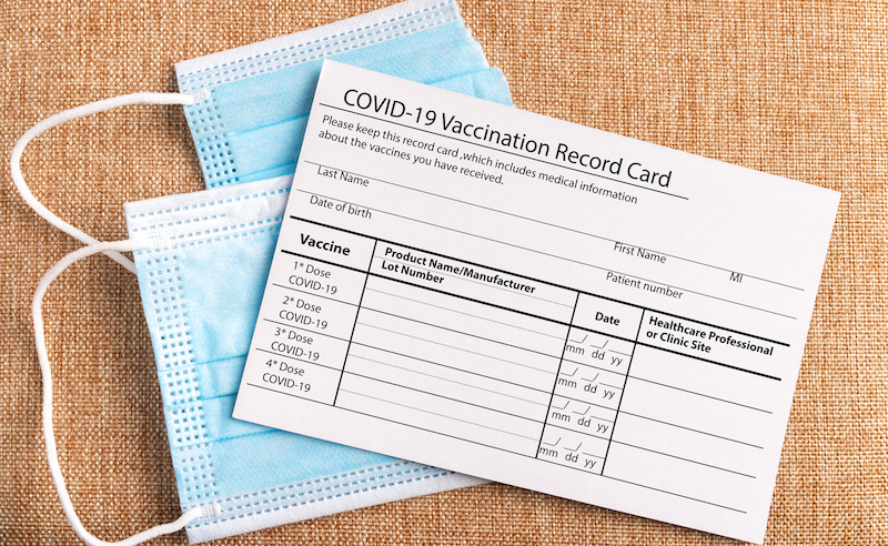 Coronavirus Vaccination Record Card. Protective Mask Divided Into Two Parts. Concept Of Defeating Covid 19