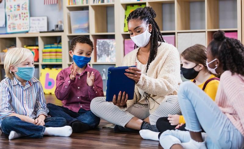 Preschool Teacher, Students In Class, Wearing Masks