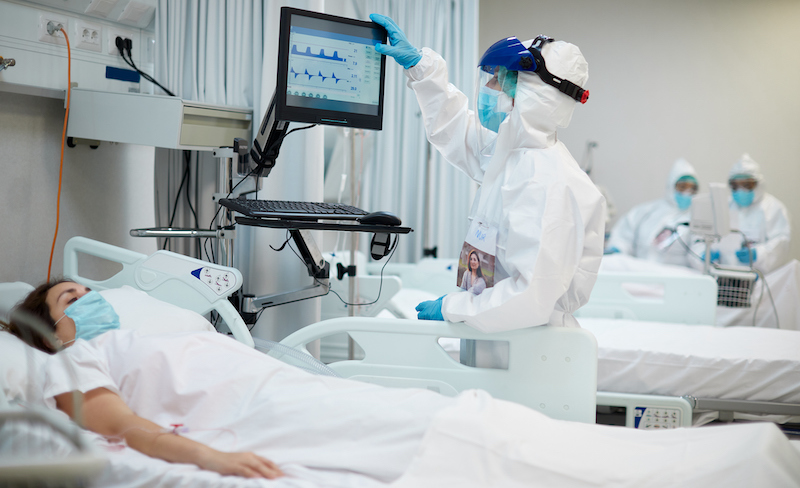 One Nurse Looking At The Medical Ventilator Screen.