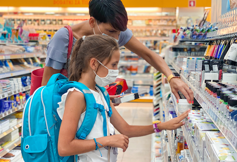 Mother And Daughter In Protective Face Mask Back To School Shopping During Covid 19 Pandemic Stock Photo