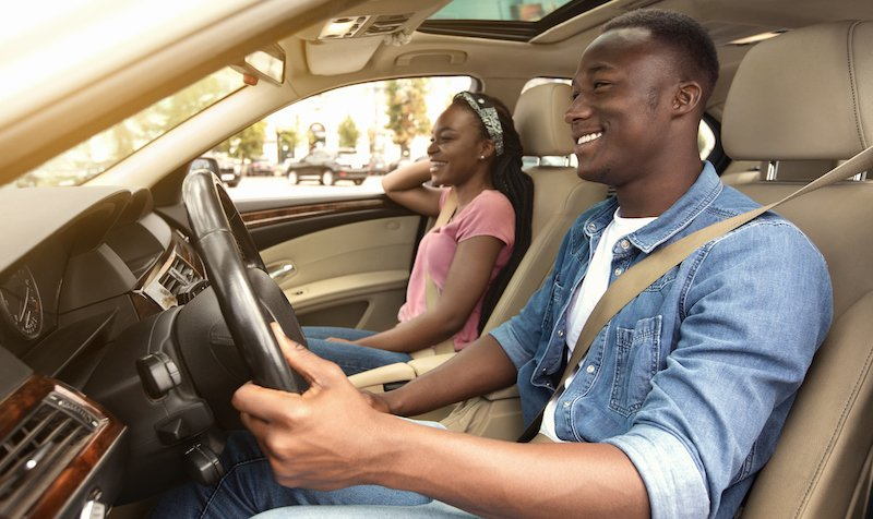 Cheerful African American Couple In Car, Side View