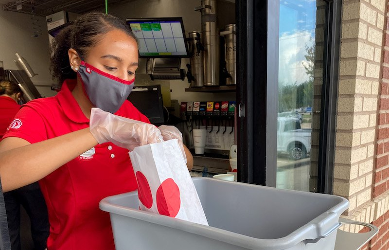 Chick Fil A Employee Servicing At Drive Through Window