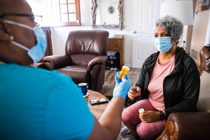 Senior Black Woman And Nurse Home Healthcare Visit