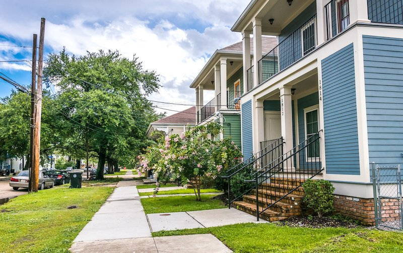 Old Wooden Houses In Colonial Style. Streets Of New Orleans After A Warm Summer Rain