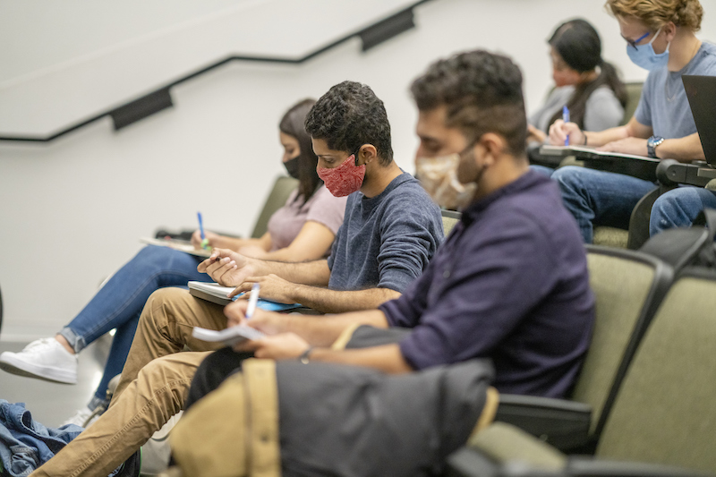 College Students Wearing Masks In A Lecture Hall