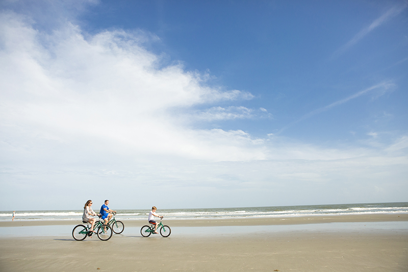 Riding Bikes On Kiawah Island Beach.