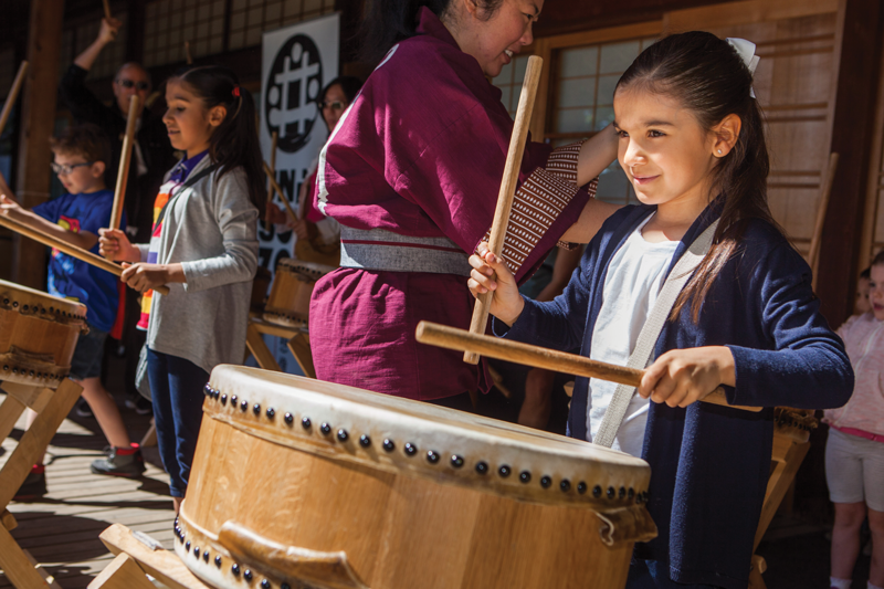 Young Girl Playing Taiko The Japanese Drum On Childrens Day. Photo By Jonathan Ley