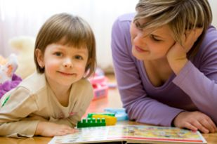 Istock 9023303 Preschool Girl Reads Mom