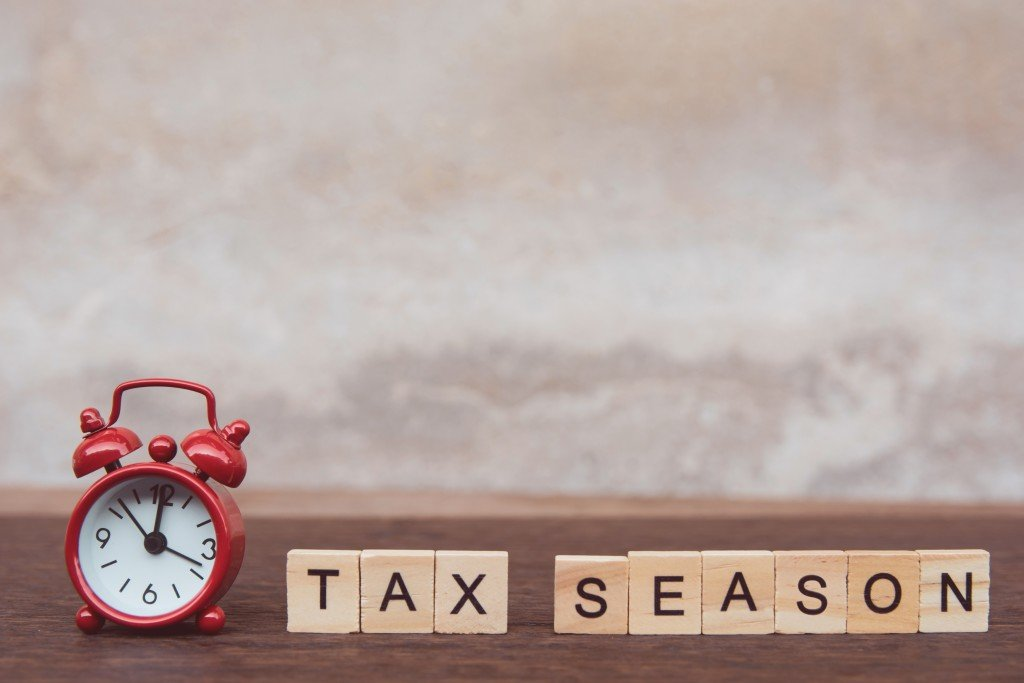 Tax,season,with,wooden,alphabet,blocks,and,red,alarm,clock,
