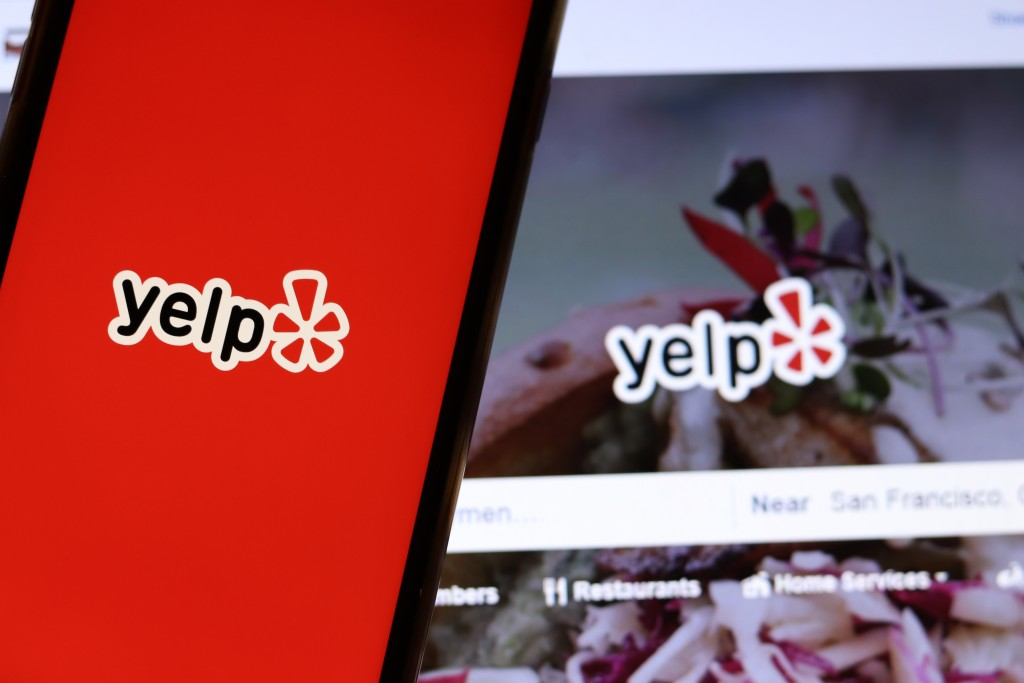 Mobile,phone,with,yelp,icon,on,full,screen,close,up
