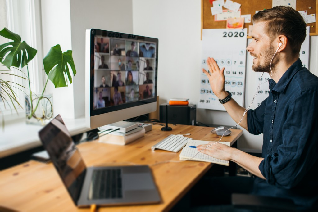 Young,man,having,video,conferencing,call,via,computer.,working,remotely