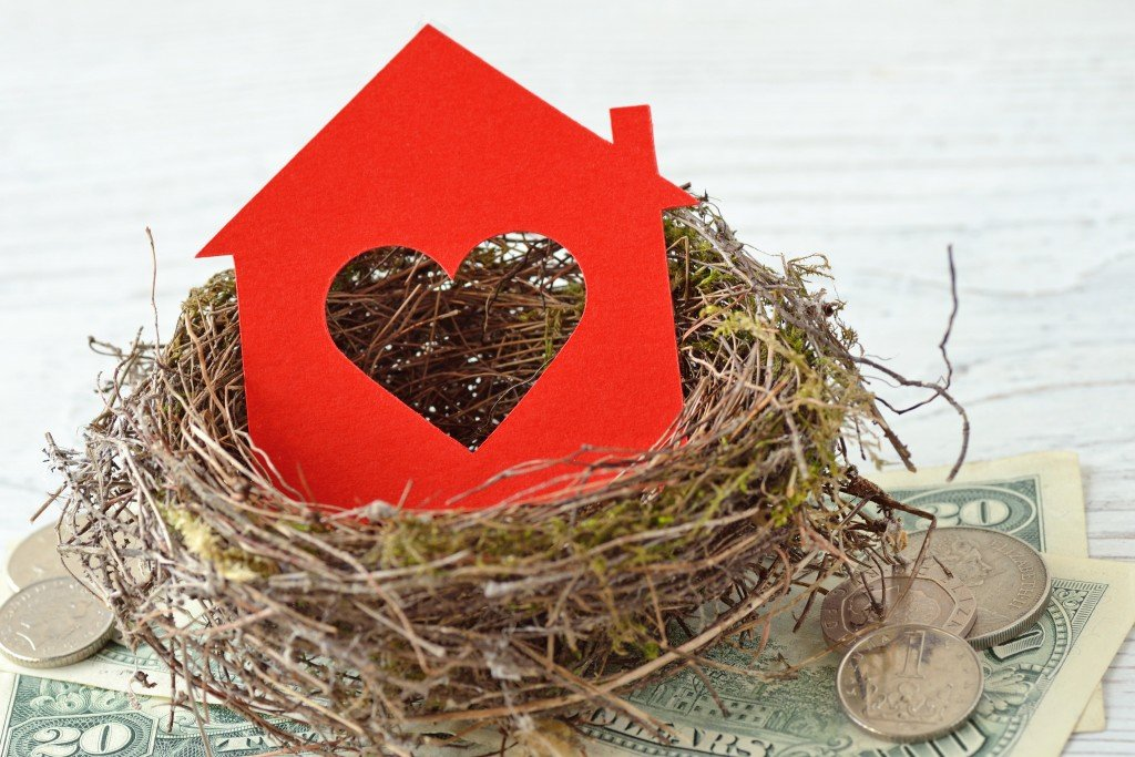 House,paper,with,heart,in,nest,on,money,background,