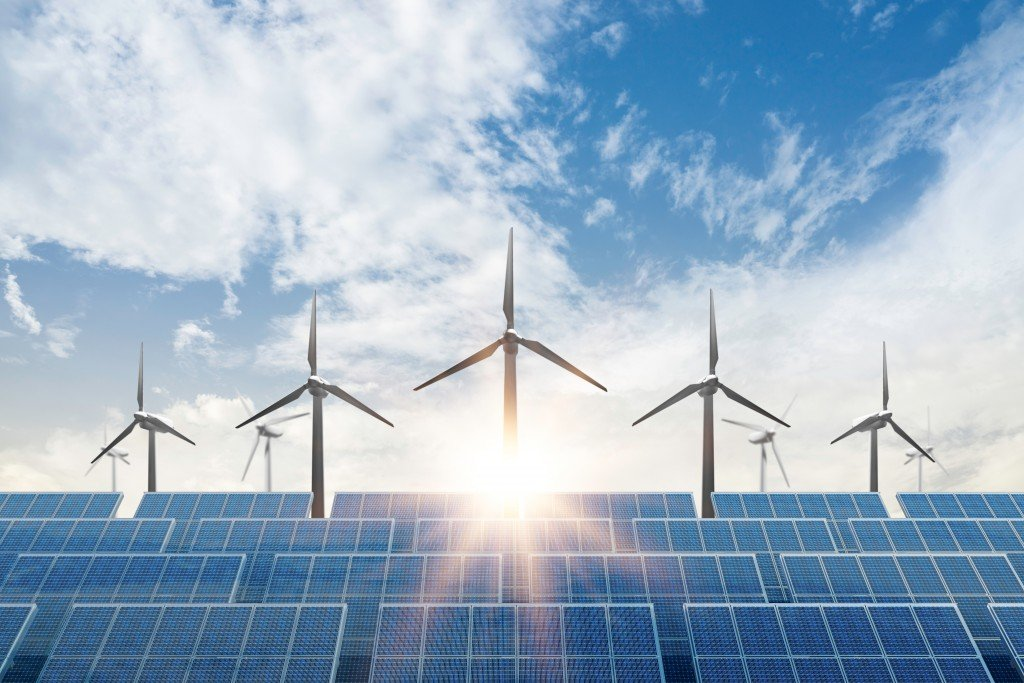 Solar,cell,plant,and,wind,generators,under,blue,sky,on