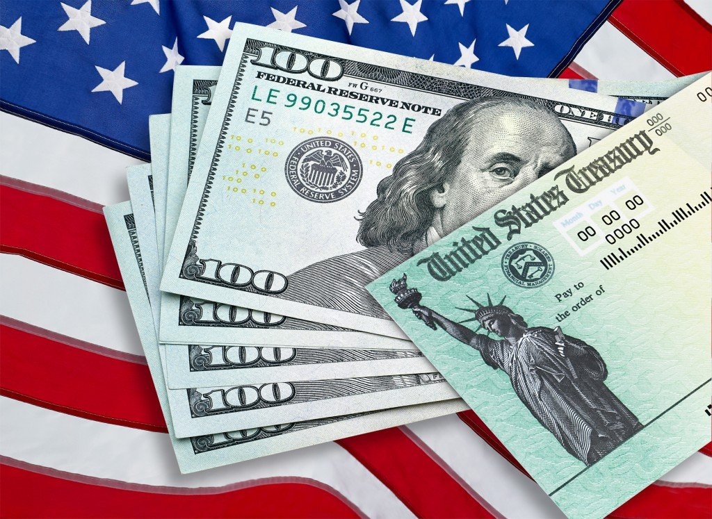 United,states,treasury,check,with,100,dollars,us,currency,and