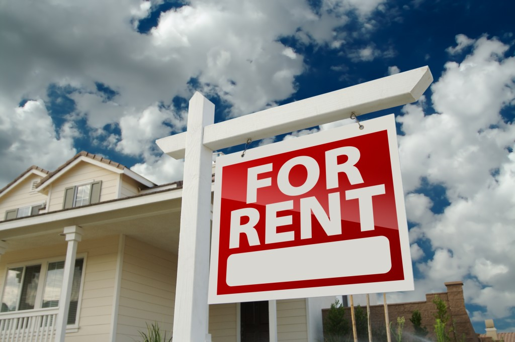 Left,facing,red,for,rent,real,estate,sign,in,front