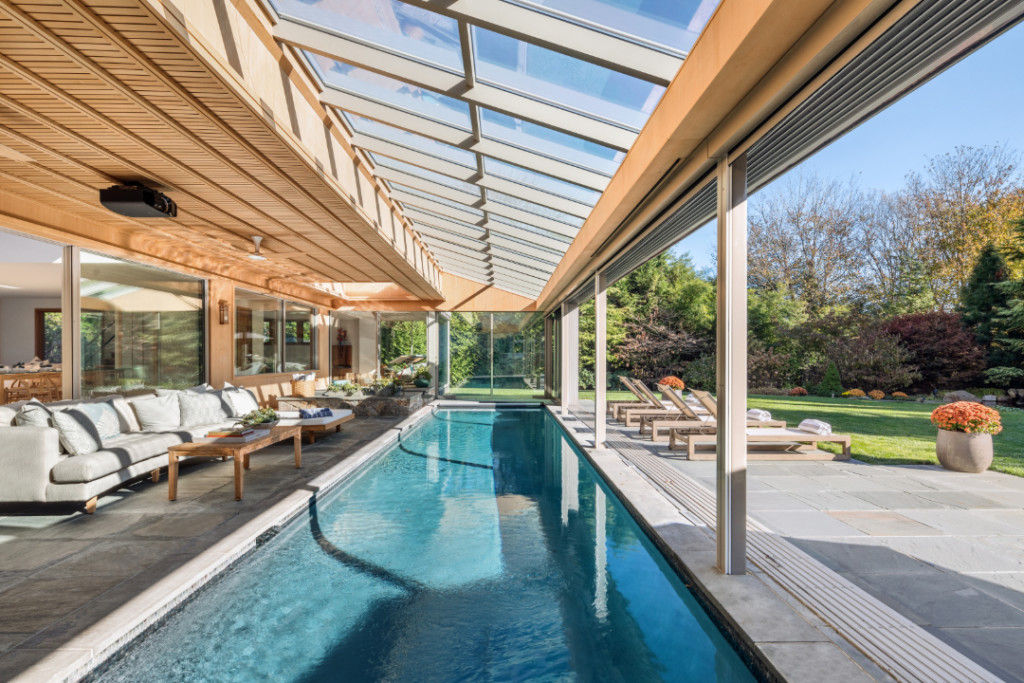 Pool side views at 38 Cobb Isle Road in Water Mill