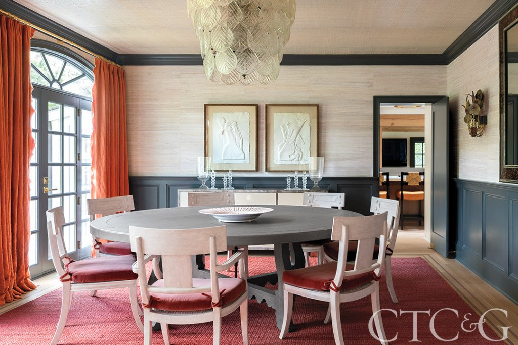 colorful modern dining room with round table