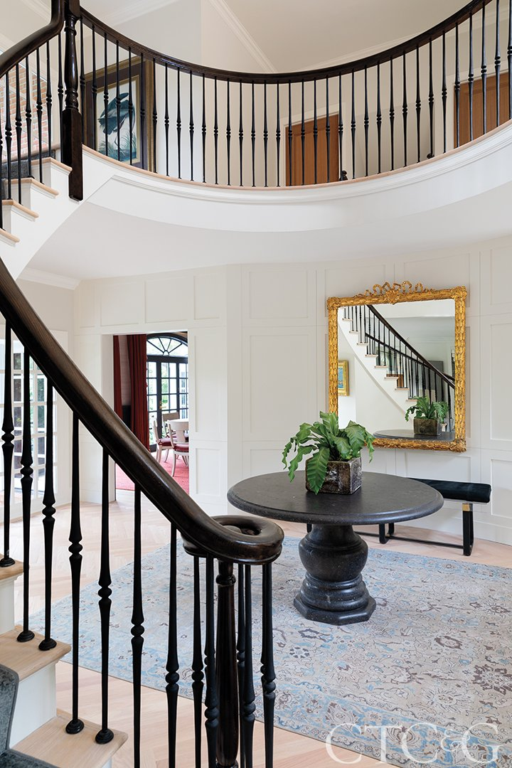 foyer with mirror and center table