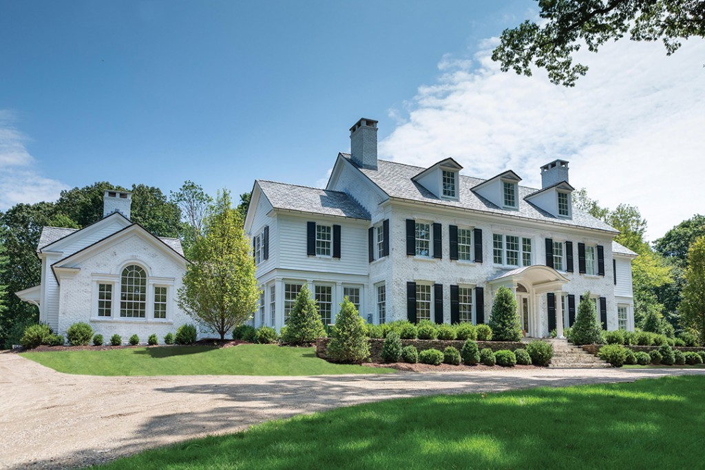white colonial with black details estate