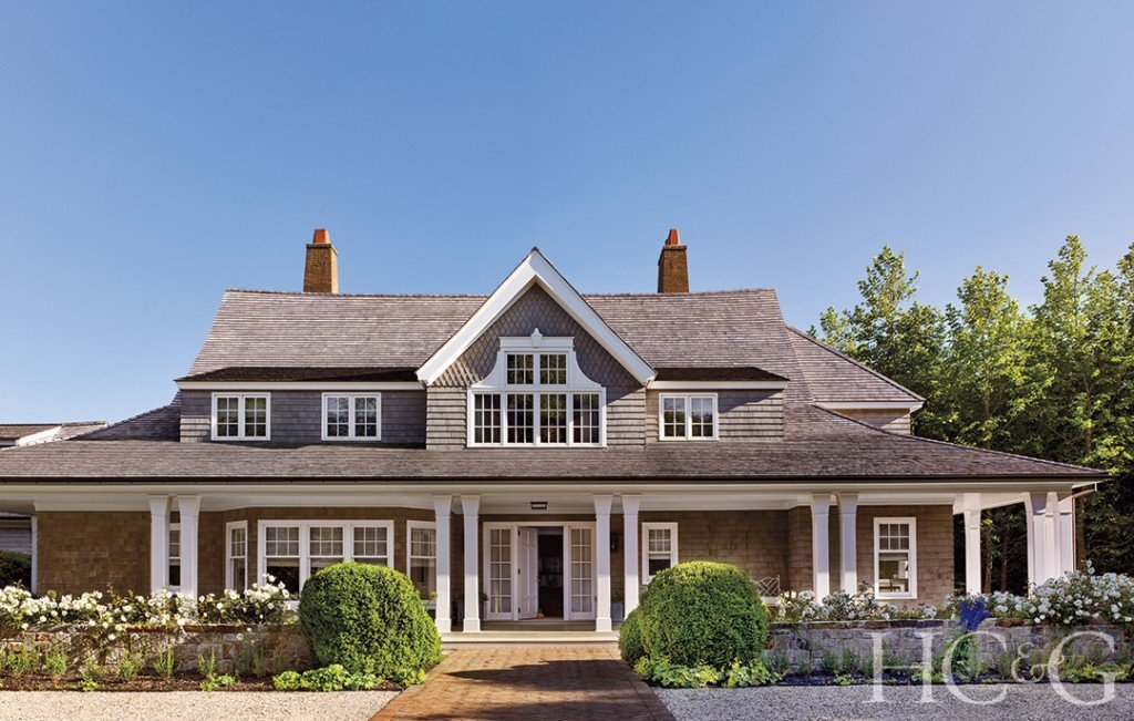 The exterior of a shingle style home.