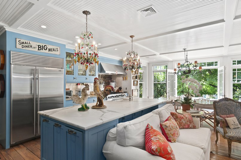 French doors and oversized windows flood the country kitchen with plenty of natural light.