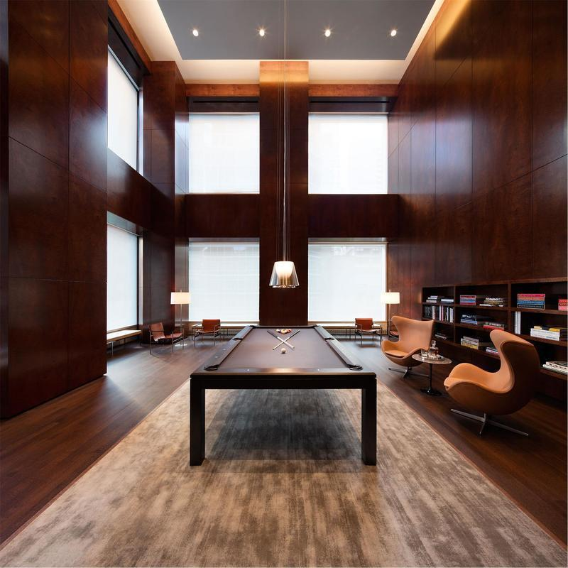 The billiards room features a soaring ceiling.