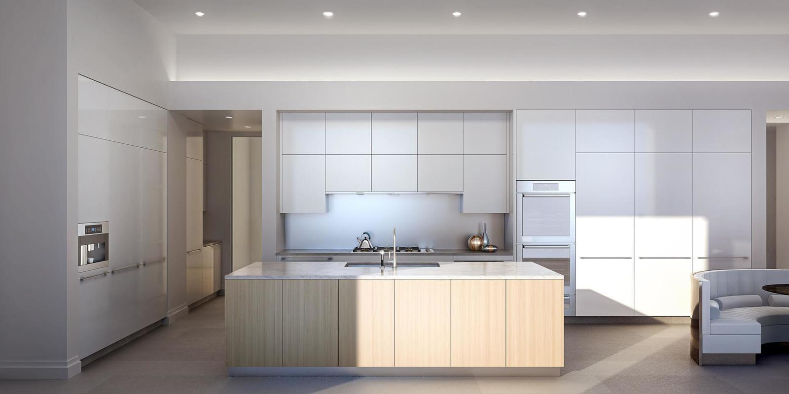 The sleek modern kitchen is outfitted with white lacquered cabinetry.