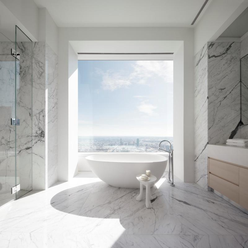 The luxurious marble-wrapped master bathroom.