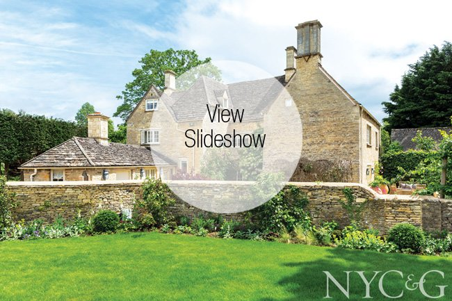 Sir Richard Branson's compound in the Cotswolds is built in the signature Cotswolds style, with thatched roofs and arched doorways.