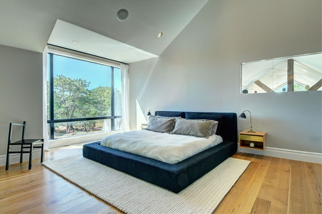 The master bedroom features a soaring vaulted ceiling.