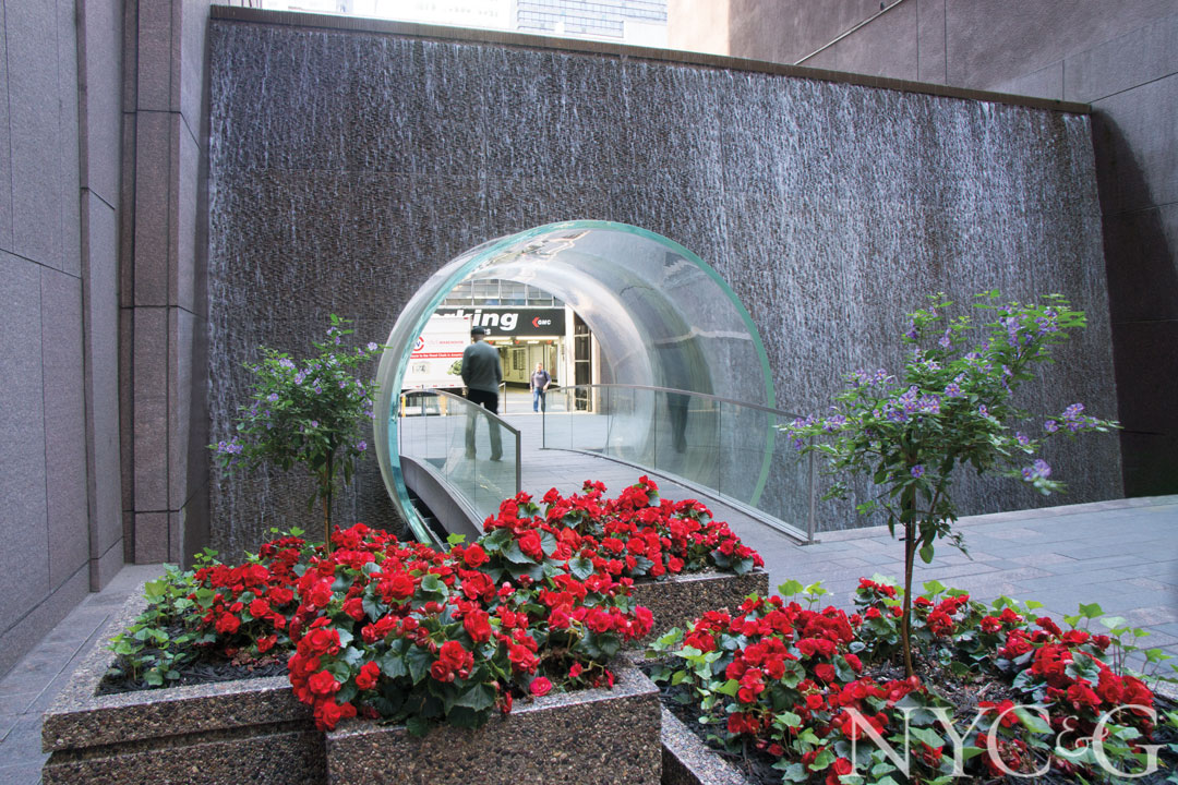 A waterfall bisects the plaza at 1221 Avenue of the Americas.