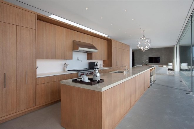 The modern kitchen is open and spacious.