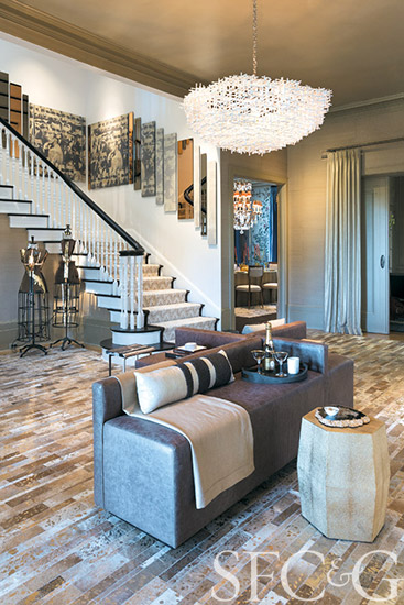 Jonathan Rachman's fashion-inspired foyer brought glam to this Pacific Heights grande dame. He transformed the entry and stairway of the traditional residence into sexy, monochromatic spaces accessorized with gold, Champagne-and-smoke-tinted mirrors and custom furnishings. Certified Kate Moss–approved.