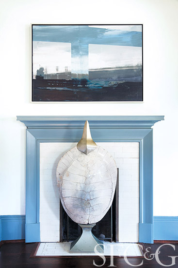 A ghostly albino turtle shell from C. Mariani Antiques is a focal point in Melanie Coddington's guest room; Emanuel Bernstone's Landscape II from Dolby Chadwick Gallery hangs above the hearth.