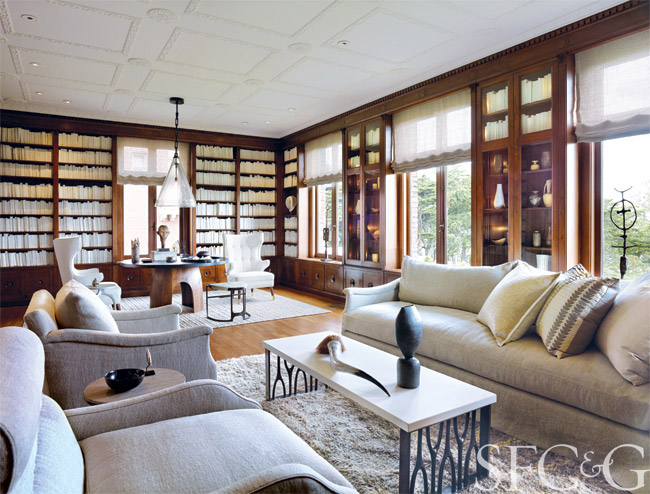 Like a great novel, Geoffrey De Sousa's library is an inspiring escape. Club chairs and a sofa upholstered in a de Le Cuona fabric invite reclining; a monumental Mattaliano glass pendant illuminates an intimate seating area with wingback chairs and a tablescape of conversation pieces; and shelves filled with hand-painted antique books merge into one highly visual volume. With his design of this urbane space, De Sousa has created the ultimate reader's retreat