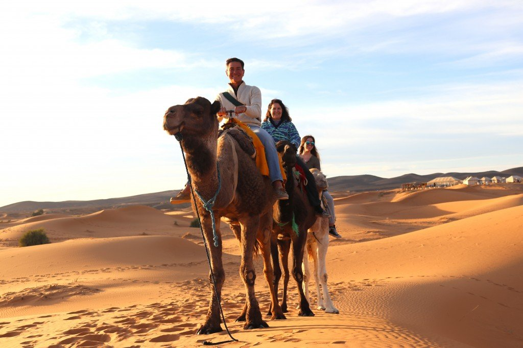 Susan Cornejo and Family on Camels in Morocco
