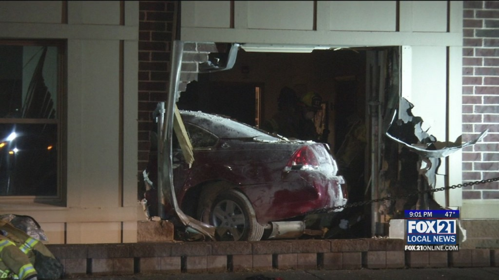 Car Crashes Into Building