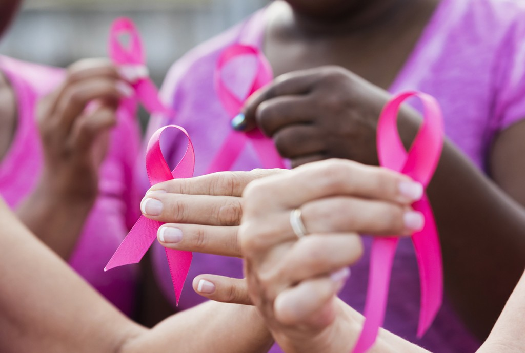 Multi Ethnic Women With Breast Cancer Awareness Ribbons