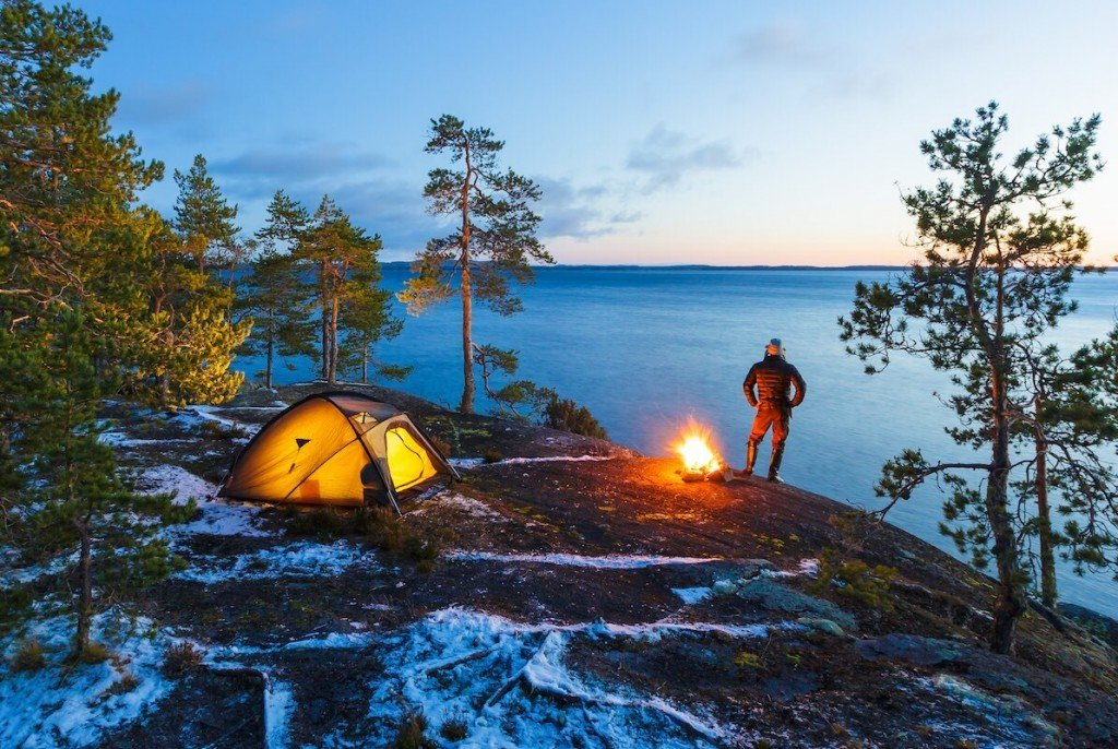 Man Is Standing Around A Campfire And Just Relaxing