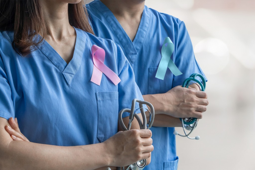 Breast Cancer Awareness Pink Ribbon Raising Awareness On Woman Health And Female Illness In October Month With Bow Color On Male And Female Surgical Doctor Gown In Clinic Or Hospital