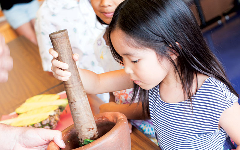 Child making pesto