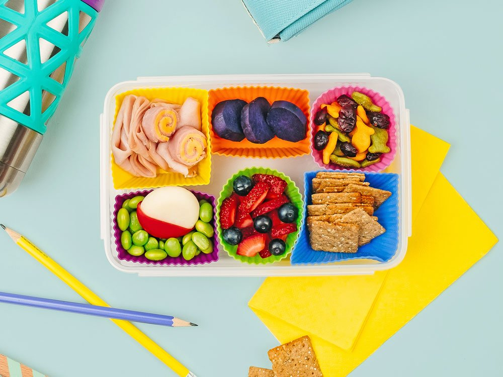 Bento box with colorful cups