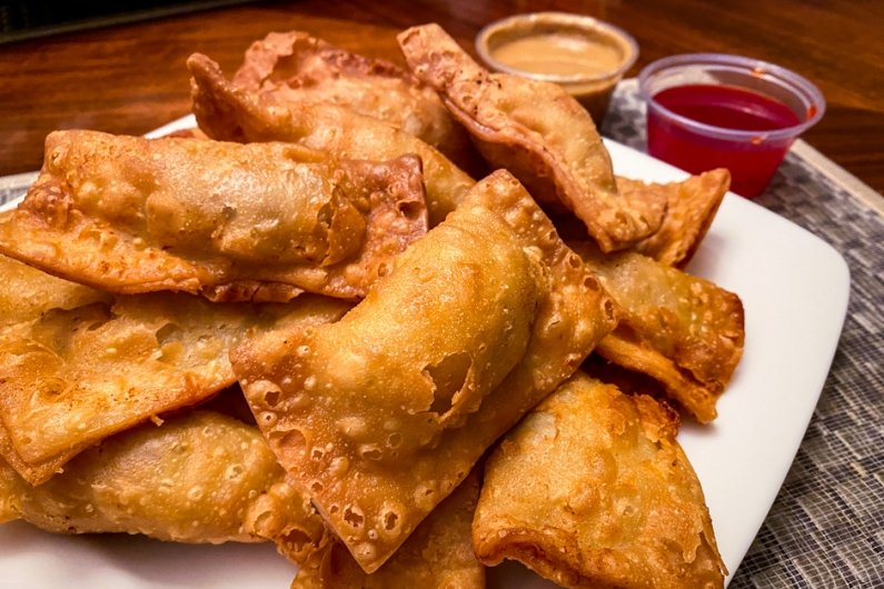 pile of golden brown crispy gau gee on a plate