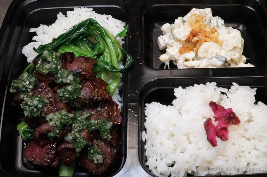 Grilled boneless kalbi with lemongrass chimichurri, choi sum, rice and mac salad ($11.50).