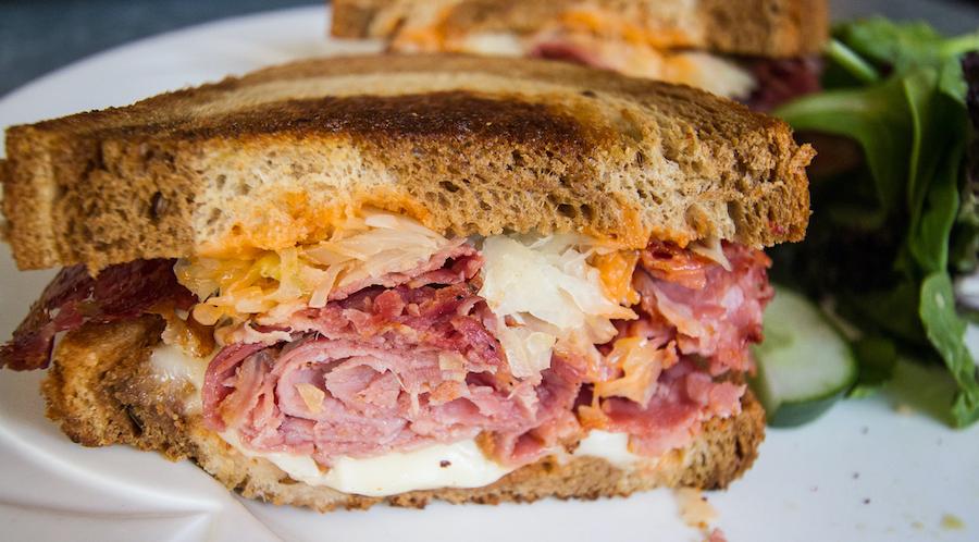 meaty cross-section of other side diner's jack ruby-en sandwich