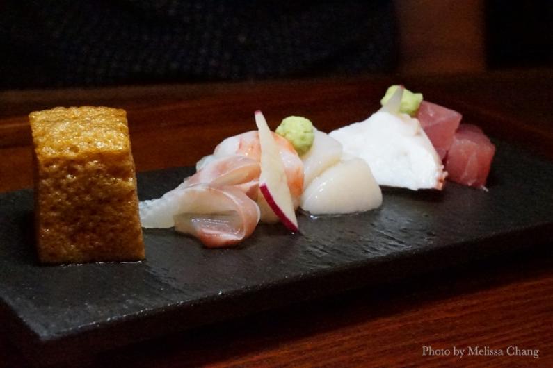 Sashimi with soy sauce cube