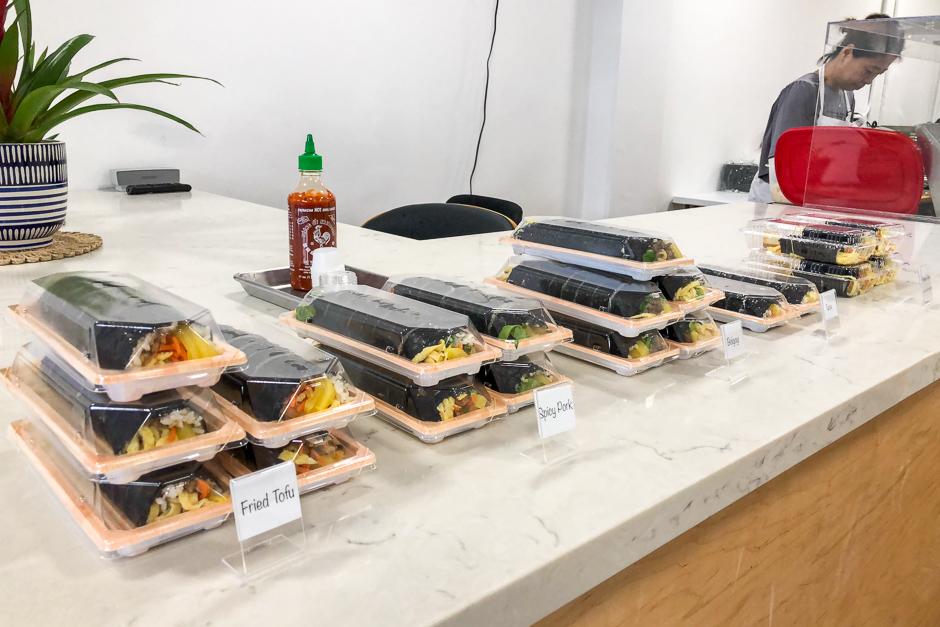 the counter at Seoul Kimbap with kimbap sushi rolls on display