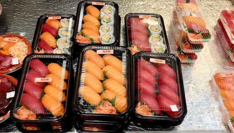 assorted packs of nigiri sushi to go